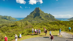 Tourists at Belvedere Lookout over Moorea Island in French Polynesia Stock Footage