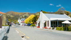 Akaroa NZ Town Street Scene with Restaurants and Shops Stock Footage