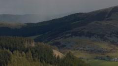 Dramatic rainstorm passes through the Manor Valley, Scottish Borders Stock Footage