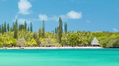 Exotic Isle of Pine Beach with Hut in Vibrant Colors Stock Footage