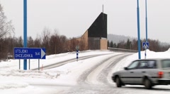 Car passes crossroad by the ice road in the arctic town of Ivalo, Finland. Stock Footage