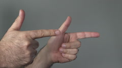 Man show guns with his fingers Stock Footage