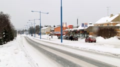 View to the road covered with ice and snow in of Ivalo, Finland. Stock Footage