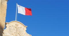 Flag of Malta on the Auberge de Castille, Valletta, Malta Stock Footage