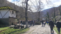 Tourists in Etar - Ethnographic museum of bulgarian architecture Stock Footage