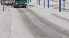 Tourist bus passes by the road in the arctic town of Ivalo, Finland. Stock Footage