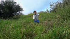 Boy run in the wild - stock footage