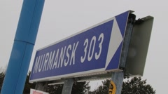 Blue traffic sign with information about distance to Murmansk in Ivalo, Finland. Stock Footage