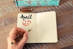 April 22 Calendar Day handwritten on notebook Stock Photos