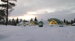 Tourists arrive to the glass igloos in Saariselka, Finland. Stock Footage