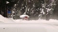 View to a bus stop in a forest in snowy winter weather in Inari, Finland. Stock Footage