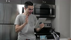 4K Video Call From Tablet Device In Kitchen Stock Footage