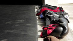 Muay Thai Boxing Gloves & Pads Lined Up On Gym Floor Next To Mats Stock Footage