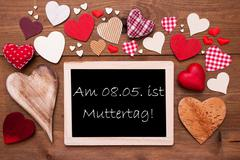 Stock Photo of One Chalkbord, Many Red Hearts, Muttertag Mean Mothers Day