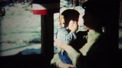 1973: Mom baby dances waving Yugoslavian national flag. Stock Footage