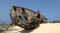 Old abandoned shipwreck on a sandy uninhabited island - Red Sea, Sudan Stock Footage