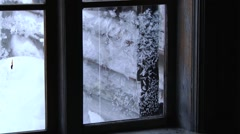 View to the ice pattern on the glass of the old wooden window. Stock Footage