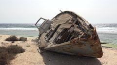 Old abandoned shipwreck on a sandy uninhabited island - Red Sea, Sudan - stock footage