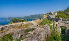 Ancient fortress walls on the shore of Adriatic sea - stock photo
