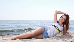 Beach holidays woman enjoying summer sun sand looking happy - stock photo