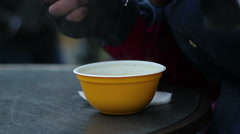 Starving poor man greedily eating hot soup from plastic bowl at homeless shelter Stock Footage