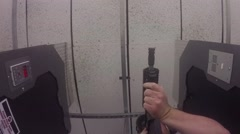 Low view of shooting AR pistol Stock Footage