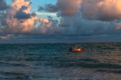 Red boat on colorful water of Atlantic ocean, Dominican Republic Stock Photos