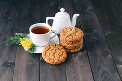 tea cup with sweet cookie - stock photo