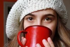 Girl with a cup of coffee in a cold day Stock Photos