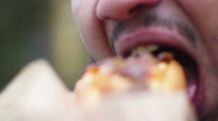 Close-up shot of man stuffing himself with fast food burger, obesity problem - stock footage