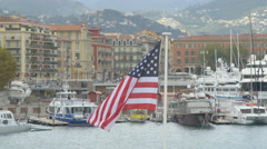 Flag of United States waving in Lympia Port, Nice Stock Footage