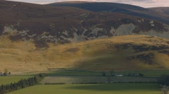 Light makes it ways across the Tweed Valley, Scottish Borders Stock Footage