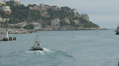 Driving a motorboat at the port of Nice Stock Footage