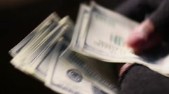 Closeup shot of male hands in shabby fingerless gloves counting cash in dollars Stock Footage