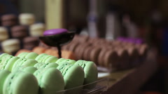 Appetizing colorful macaron sweets at confectionery window, delicious dessert Stock Footage