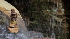 Peacefully Stacked Rock Cairn Is Showered On By Waterfall Stock Footage