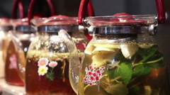 Fruit and herbal tea in cafe, variety of warm drinks served to festival guests Stock Footage