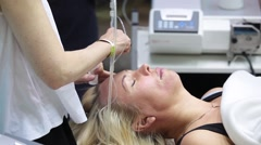 Woman during a session of mesotherapy in spa beauty salon - stock footage