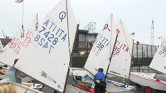the young sailors  kids arming the sail boat - stock footage