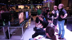Gamers playing video games, annual Mortal Kombat tournament Stock Footage