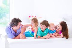 Happy big family in a bed - stock photo