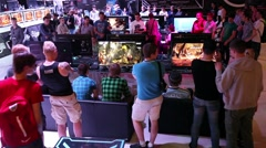 Gamers playing video games, annual Mortal Kombat tournament - stock footage