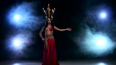 Attractive belly dancer go on dancing with candles, her head, black, smoke - stock footage