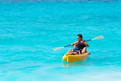 Father and son on a kayak ride in a tropical blue sea Kuvituskuvat