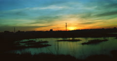 Twilight in the city.Sunset in Bucharest,Romania, in Vacaresti Natural Park,4k Stock Footage