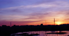 Twilight in the city.Sunset in Bucharest,Romania, in Vacaresti Natural Park,pan - stock footage