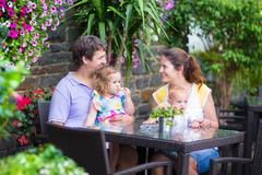 Family eating lunch in outdoor cafe Stock Photos
