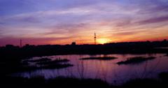 Twilight in the city.Sunset in Bucharest,Romania, in Vacaresti Delta,4k,zoom in Stock Footage