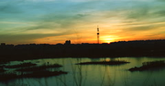 Twilight in the city.Sunset in Bucharest,Romania, in Vacaresti Delta,4k,zoom out Stock Footage