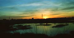 Twilight in the city.Sunset in Bucharest,Romania, in Vacaresti Delta,4k, zoom in Stock Footage